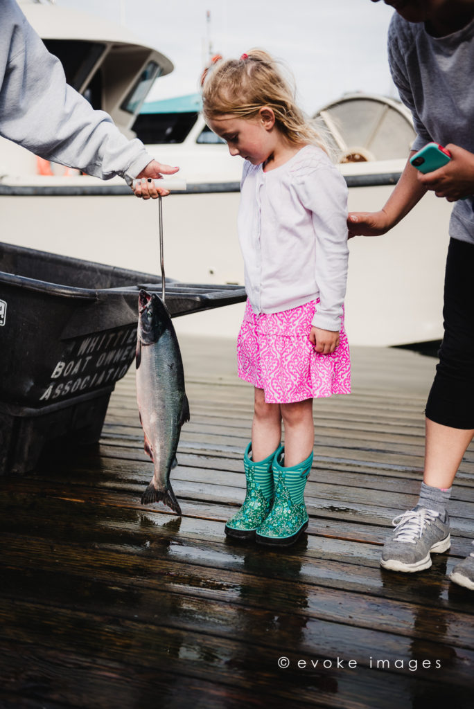 little girl catching salmon alaska kingfisher