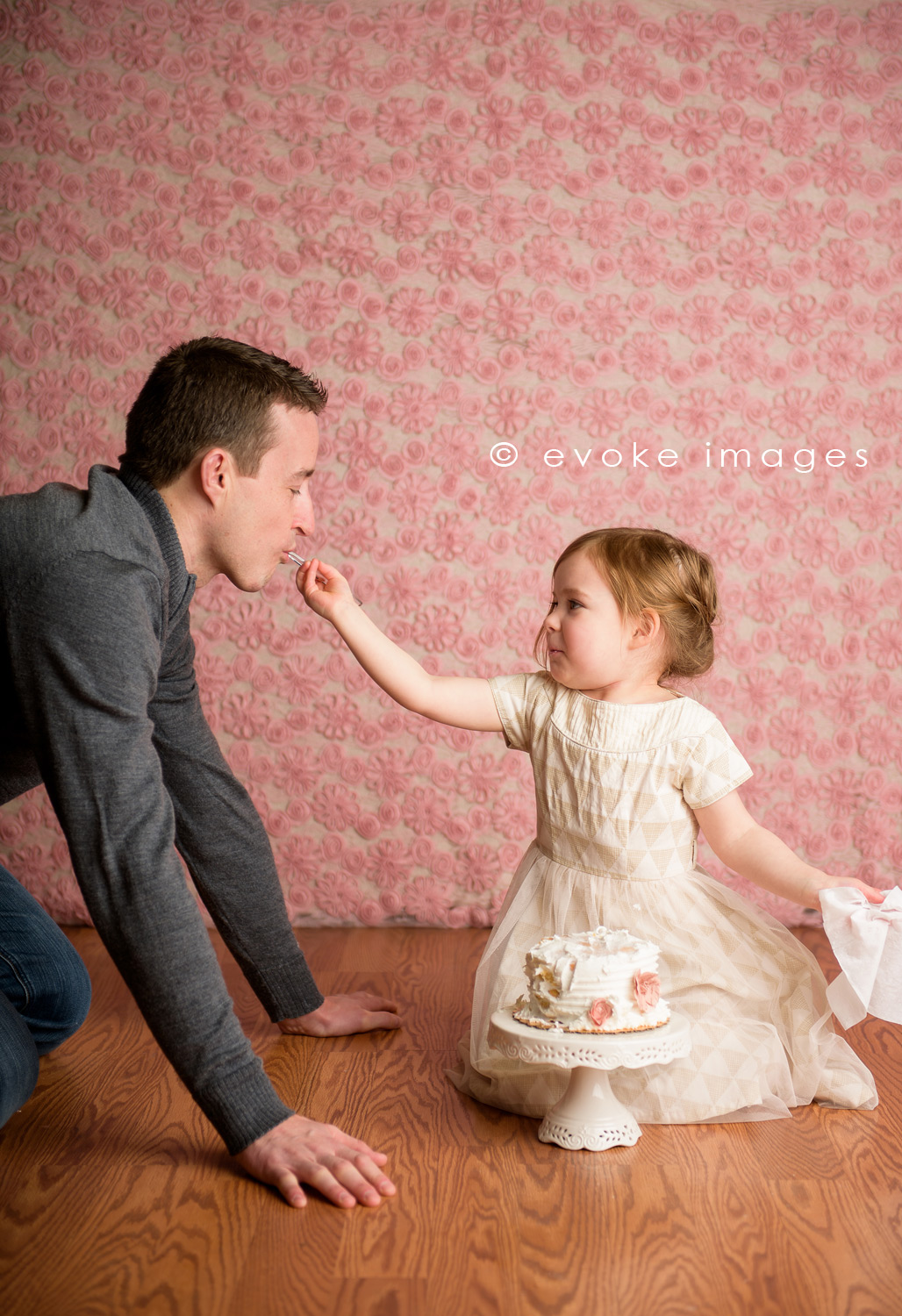 daddy daughter sharing cake